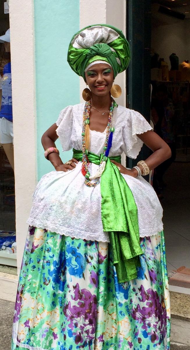 Local woman in Baiana de Acarajé, the traditional dress of Bahia
